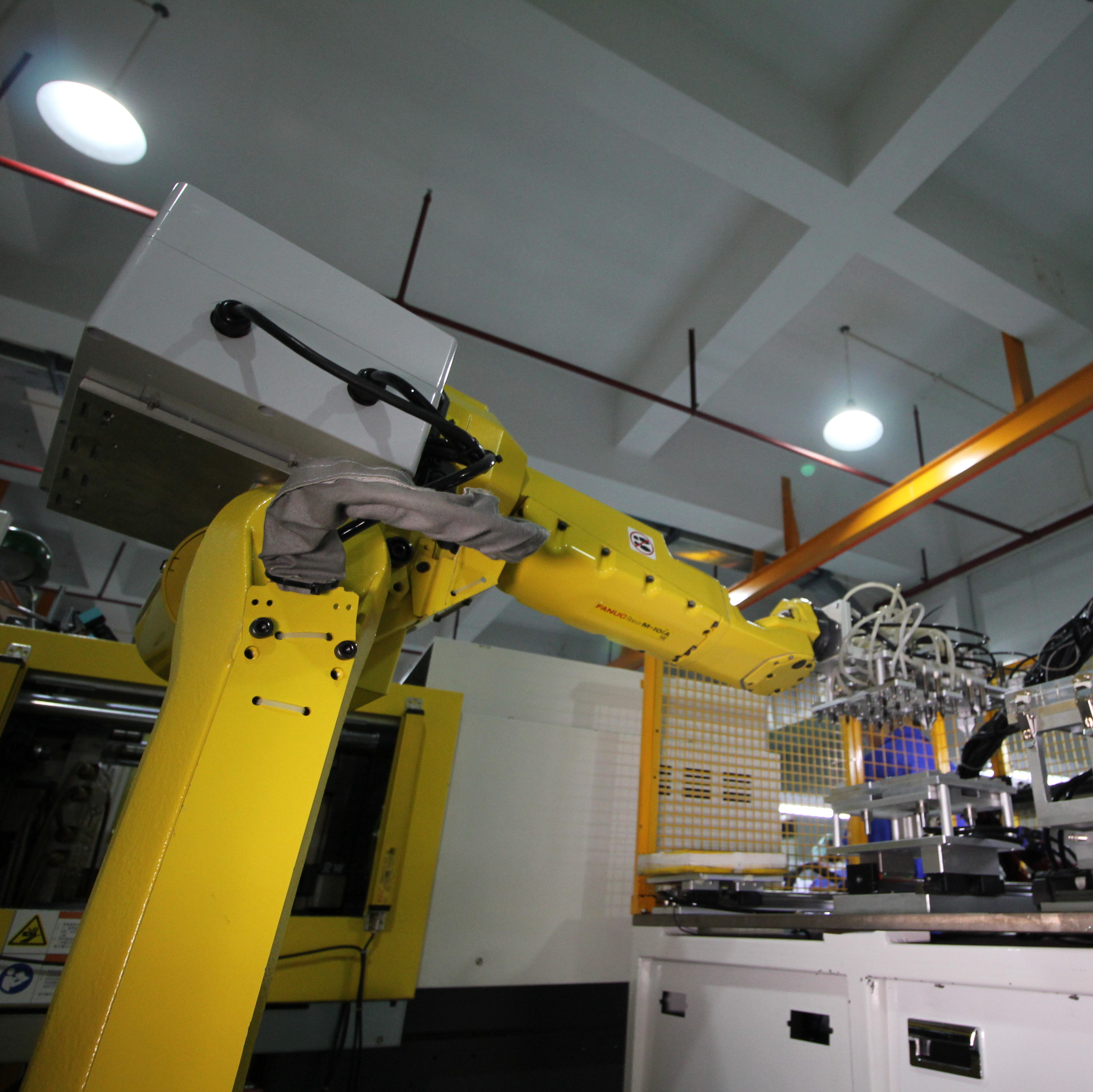 Pearl Engineered Solutions custom-made insert molding equipment provides high speed precision manufacturing